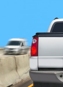 White pickup with truck stopped on freeway in left lane near concrete - Tonneau covers