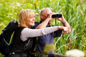 enior Couple Bird Watching with Binoculars