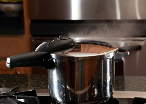 Steam escaping from lid of pressure cookers