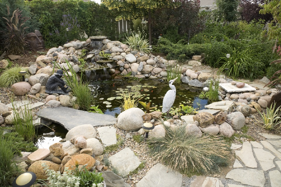5 simple backyard pond ideas blain 39 s farm fleet blog for Landscaping around a small pond